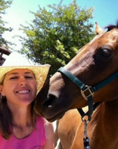 Tiffany MacNeil photo with hat and horse