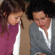 Photo of Stephanie with child girl