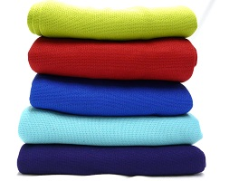 Discovery Trekking Towels stacked in a variety of colors