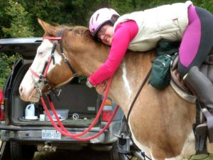 For the Love of Endurance Riding Ashley on Splash hugging her around the neck